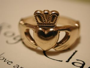 The ring is worn on the right hand.  When the crown and the heart are facing out, it means that the heart of the wearer has yet to won.  When the wearer is in love, the ring with worn with the heart and crown facing inwards.  When the wearer is married/in a very committed relationship, the ring is worn on the left hand with the crown and heart facing out.  OH AMOR!