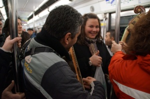 Getting serenaded on the metro...I had to pay 1 euro for this, HAPPY BIRFDAY Christine.