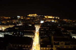 The view from the top level of the elevator at night.  The castle of St. Jorge is in the center back of the picture.
