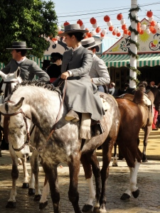 """I can only hope I can look this classy while riding in a suit dress, side-saddle, in the unnormal April heat, drinking """"mojitos"""" as this woman does."""
