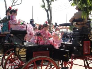 These chicas were the most adorable things ever.  Plus, the are riding like it's dirty in their sweet carriage.