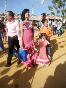 This little one can't be older than 8 and she already looks fierce in her feria get up.