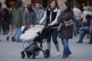 This is the perfect example of how babies travel in style here in Spain.  They are dressed to the 9's and are zipped into this nugget blanket things.