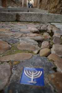 All over the streets of Toledo there are tiles with Muslim symbols, Christian symbols, and Jewish symbols to represent the co-existance of these religions.