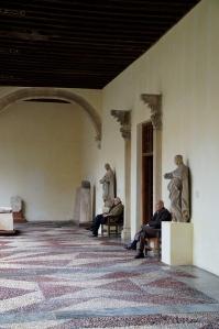 Typical Spanish men waiting for their Mujeres (wives) at the Museo de Santa Cruz.