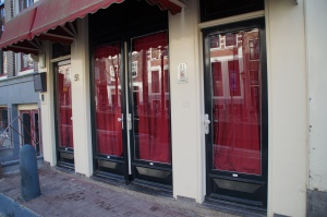 The famous window doors of the Red Light District.  Woof.  That story needs to be told in person.