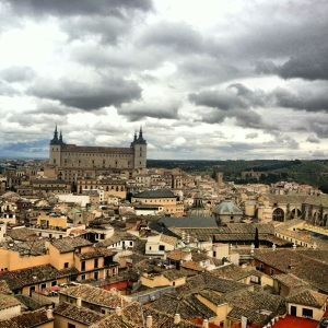 In the back in the Alcazar.  It isn't pictured, but the Cathedral of Toledo would be on the right of the picture.