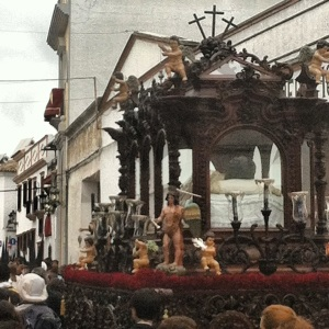 The glass casket of Jesus after he has been crucified.  The band even played the funeral march for him.
