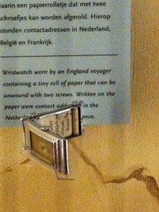 This is a watch head.  Behind the face of the watch is a dissolvable piece of paper with more codes of information.