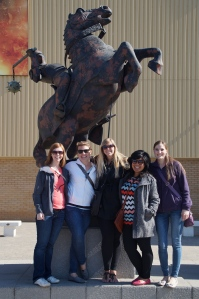 The group in front of the giant Wizard's Chess pieces used in the Sorcerer's Stone.