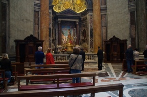 I was a terrible American and snuck a shot of us at Mass IN ST. PETER'S BASILICA!