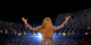 This classic movie is the Lizzie McGuire movie where she goes to Rome and gets mistaken as a Italian pop star (such a difficult problem).  At the end she has an amazing concert at the end where she performs in the Colosseum (because that happens everyday).
