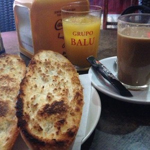 The best breakfast ever:  Tostada con jamon y aciete and café con leche.