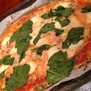 I created a salmon, mozzarella, and spinach pizza.